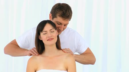 massages : Man giving a massage to his young wife at home