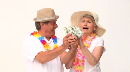 изобилие : Couple in vacation showing off their cash against a white background Стоковые видеозаписи