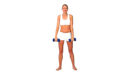 aeróbica : Woman in sportswear with dumbbells isolated on a white background