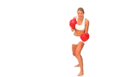puncs : Woman with red boxing gloves in sportswear isolated on a white background Stock mozgókép