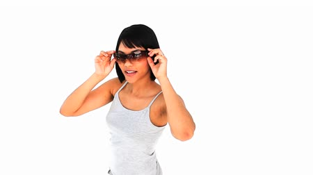 korejština : Casual chinese woman with sunglasses against a white background