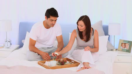 morning : Cute couple taking the breakfast together on their bed