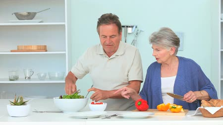 senior lifestyle : Cute mature couple preparing the dinner in the kitchen