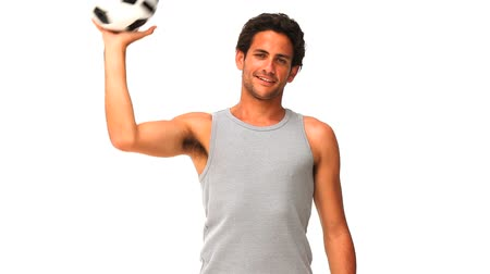 trik : Handsome man with a soccer ball isolated on a white background