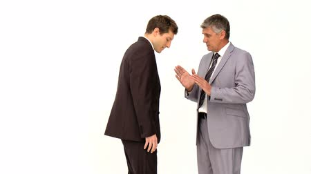 két : Businessman giving an explanation to his employee against a white background