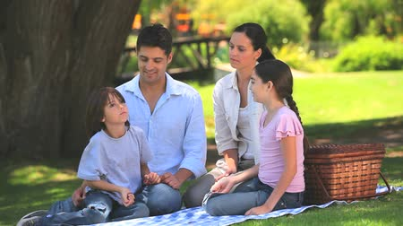 пикник : Cute family having a picnic outdoors