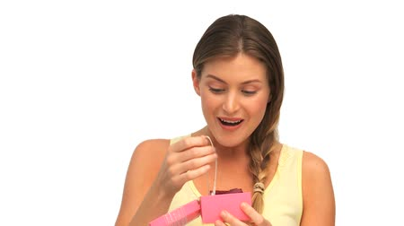presentes : Beautiful woman opening her gift Stock Footage