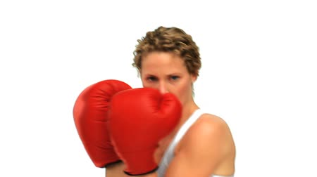boxe : Dynamic woman with red boxing gloves isolated on a white background