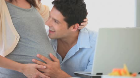 mother love : Man listening to the belly of his wife Stock Footage
