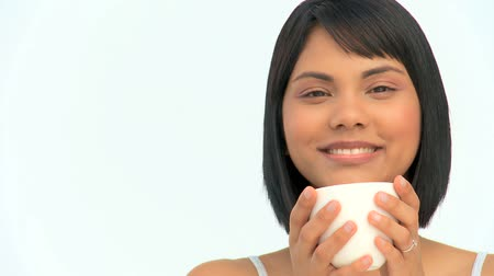 белый : Cute asian woman drinking a coffee isolated on a white background