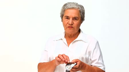 um : Retired woman eating chcolate Stock Footage