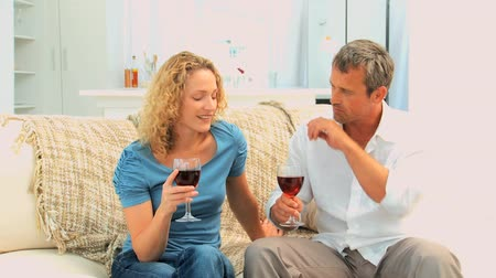 vinho : Lovely couple enjoying a french wine on their couch