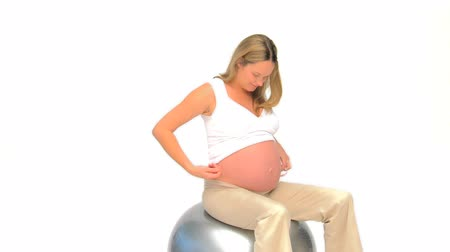 excuses : Pregnant woman measuring her waist against a white background