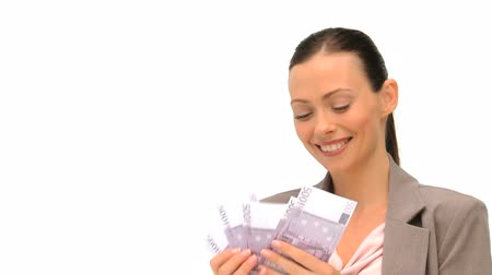 sayma : Joyful businesswoman counting her money against a white background