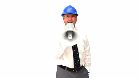 megafon : An mature architect shouting through a loudspeaker against a white background