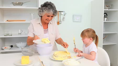 бабушка : Little girl baking with her Grandmother