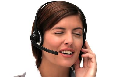 üzleti öltöny : Brunette businesswoman speaking over the headset isolated on a white background