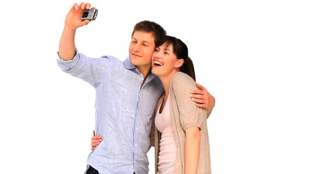 öz : Cute couple taking a picture of themself isolated on a white background Stok Video