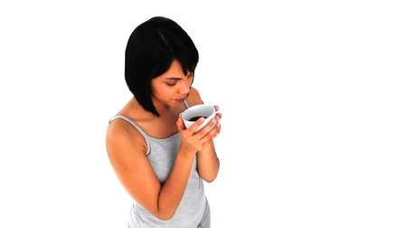smell : Chinese woman taking a coffee isolated on a white background Stock Footage