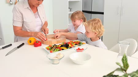 placas : Grandmother cooking with her adorable grandchildren