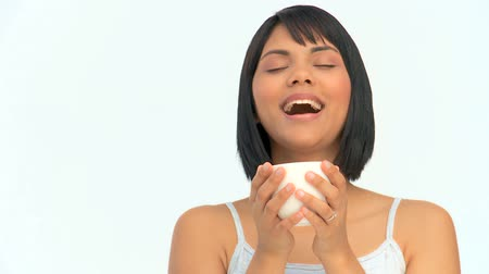 smell : Asian woman enjoying a cup of coffee isolated on a white background