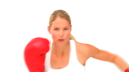 кулак : Dynamic woman with red boxing gloves isolated on a white background