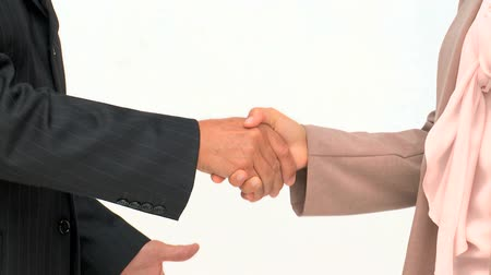рукопожатие : Hands of two business people isolated on a white background Стоковые видеозаписи