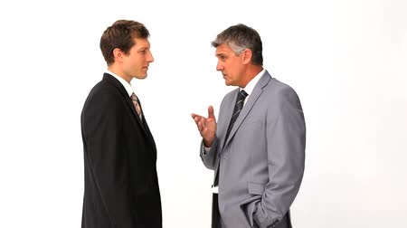 vzrušený : Businessman explaining something to his employee against a white background