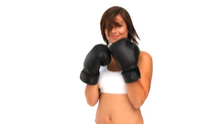 puncs : Coquette woman in sportswear with boxing gloves against a white background