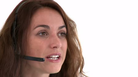 earpiece : Cheerful hispanic businesswoman wearing headset against a white background