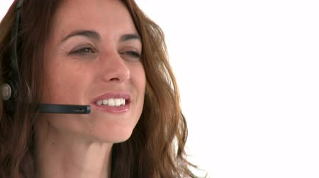 earpiece : Self-assured hispanic businesswoman wearing headset against a white background Stock Footage