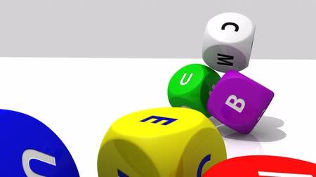размеры : Rolling multicolour dices against a white background Стоковые видеозаписи