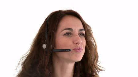 earpiece : Portrait of a serious hispanic businesswoman with earpiece against a white background