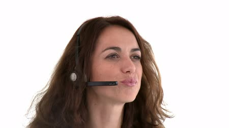 segít : Cute hispanic businesswoman wearing headset against a white background Stock mozgókép