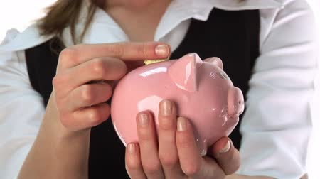 bancos : Woman Saving Money in a Piggy Bank