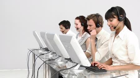 irodaház : Multi-ethnic business people working in a call center with headset on