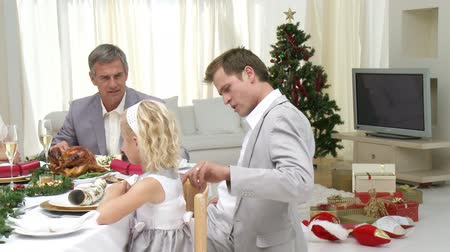 vacsora : Family Sitting Down to Christmas Dinner in high definition 1080p Stock mozgókép