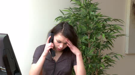 disinterest : Irritate woman talking on phone at home