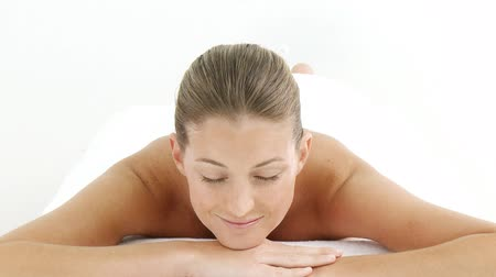 massages : Montage of a pretty woman relaxing in a spa center in HD Stock Footage