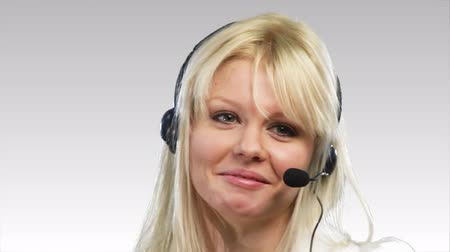 clerical : Beautiful Blonde Caucasian Woman talking on a headset