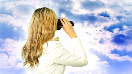 career success : Young Business Woman looking through Binoculars Stock Footage