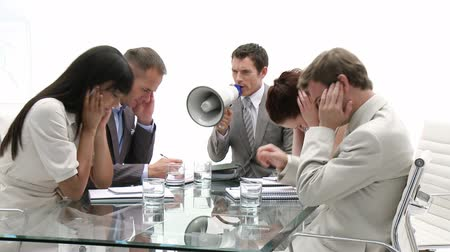 boss : Businessman shouting through a megaphone in a meeting with his team Stock Footage