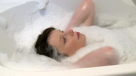 wanna : Beautiful woman having a bath at home