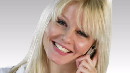 titkár : Attractive Caucasian Businesswoman talking on the phone