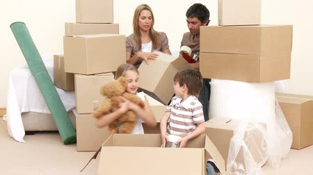 home life : Family moving house. Parents and children unpacking boxes. Footage in high definition Stock Footage