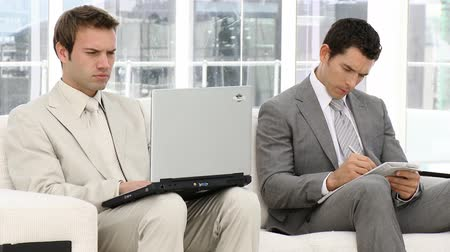 suit and tie : Serious businessmen working sitting on a sofa