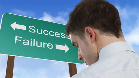 career path : Businessman standing in front of a success and failure sign