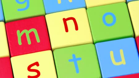 alphabet : High view of colorful alphabet toy blocks turning footage in high definition