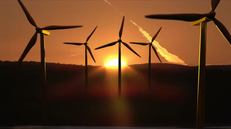 climate : Wind Turbines in motion in HD. Excellent for showing renewable energy and climate change concepts Stock Footage