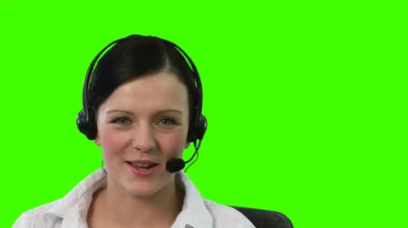 titkár : Green screen footage of a woman on a Headset